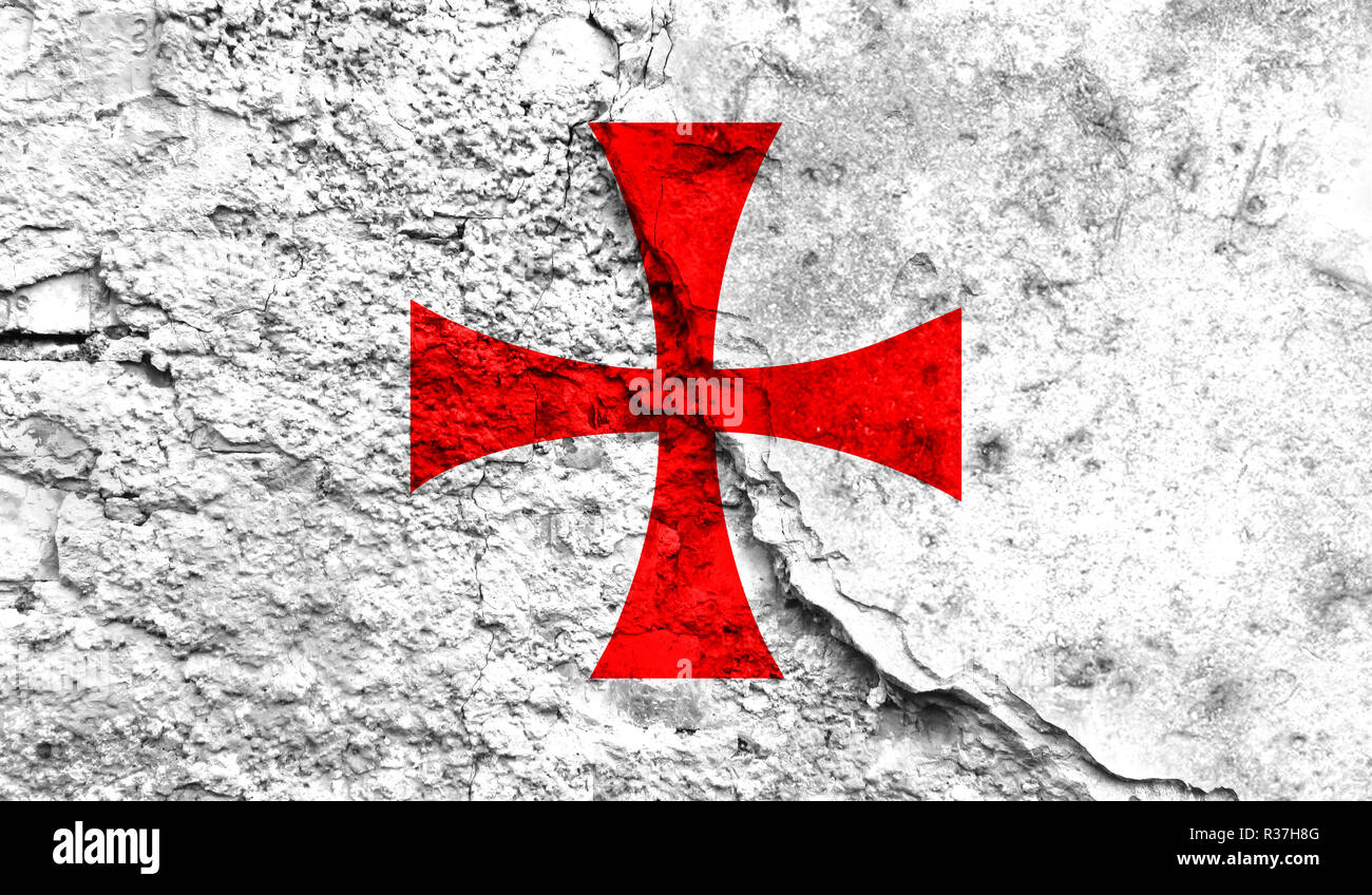 Flag of templiers close up painted on a cracked wall, concept of armed actions and conflicts in the world - Stock Image