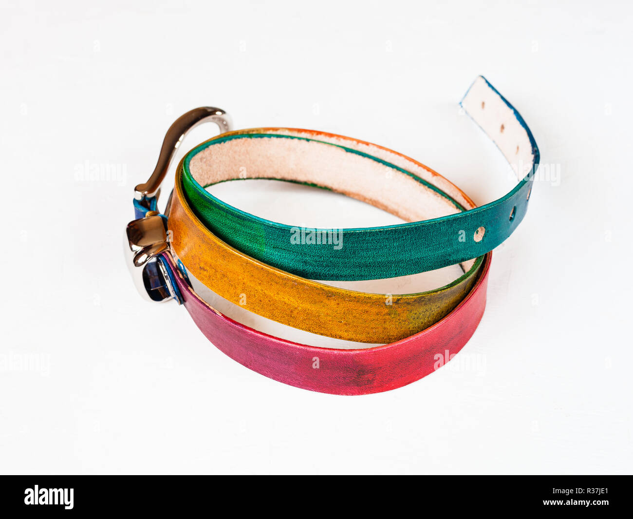 hand painted multi colour leather belt on white background - Stock Image