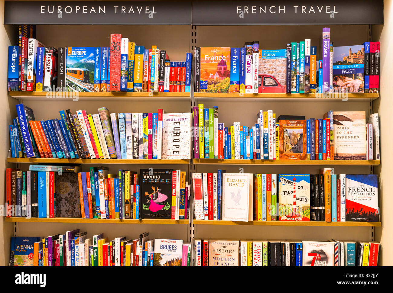Travel guide book on sales on shelves of local Bookshop in Cambridge, England, UK - Stock Image