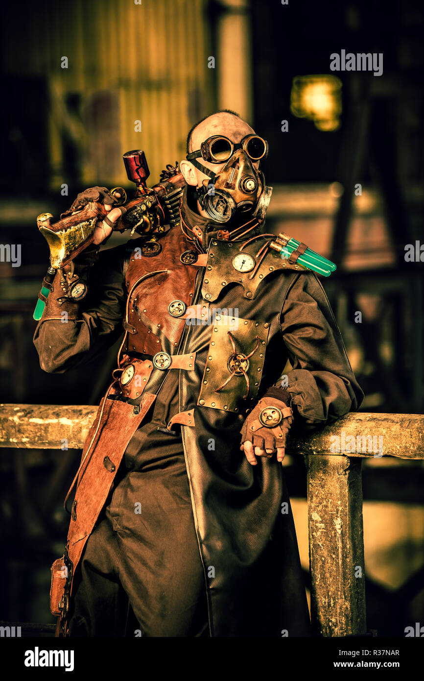 Steampunk man stands guard - Stock Image