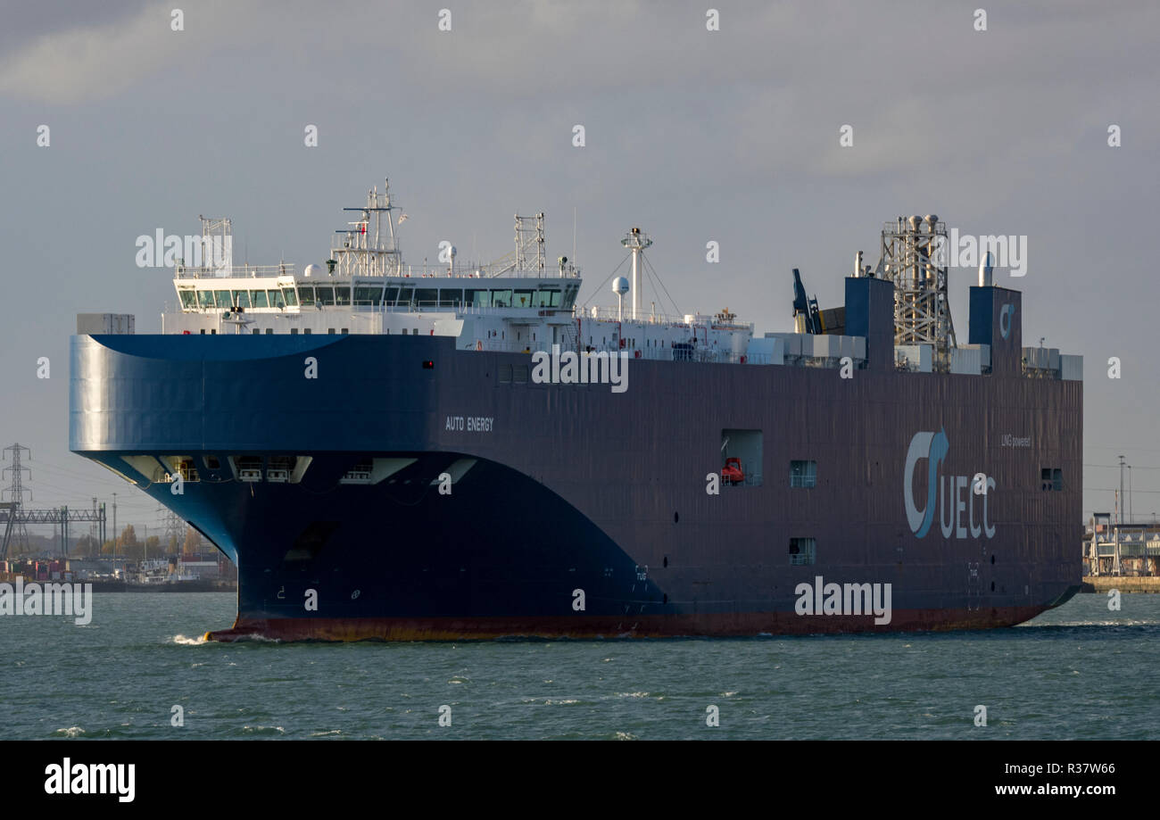 a large UECC car transporter ship or vessel in the port of southampton docks. car transporter and importing cars by sea transport. - Stock Image