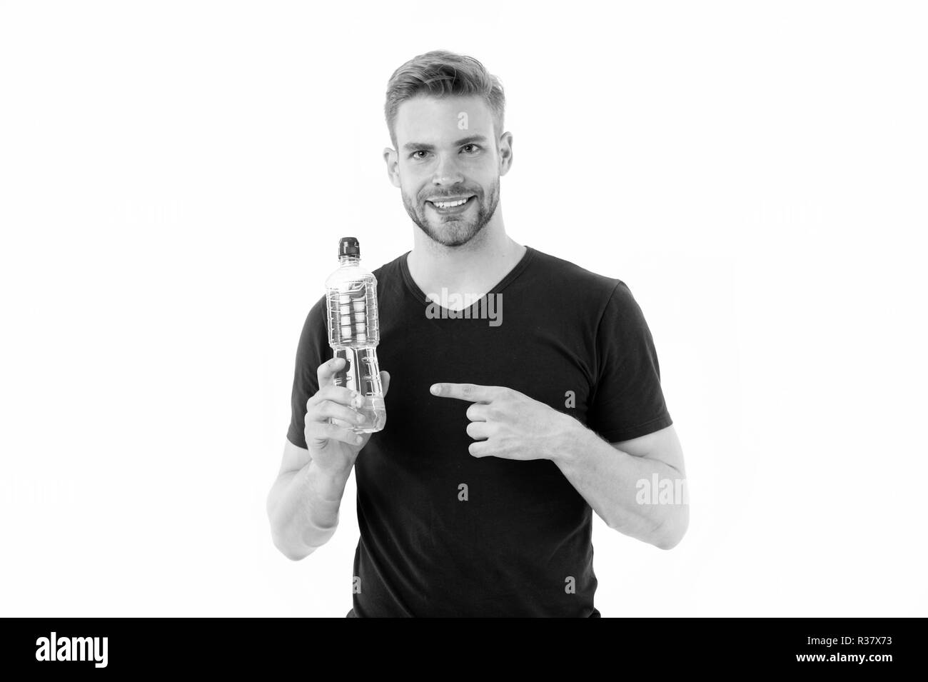Macho point finger at water bottle isolated on white. Happy man smile with plastic bottle. Thirst and health. Stay hydrated and healthy. Drinking water for health. Presenting product. - Stock Image