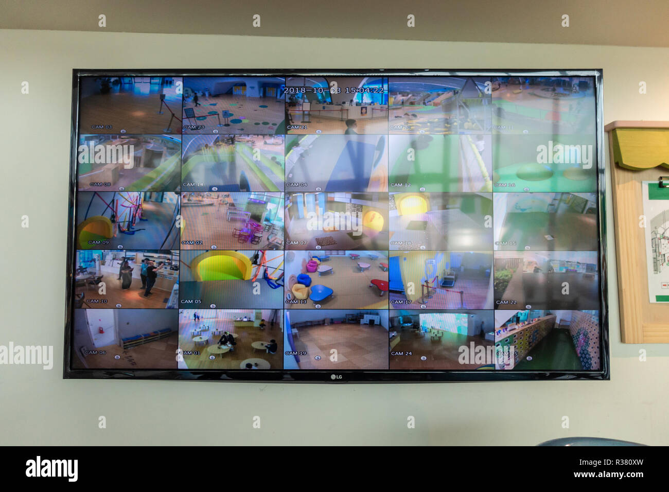 A CCTV system at a children's play center on Seoul allows parents to monitor their children whilst remaining seated. - Stock Image