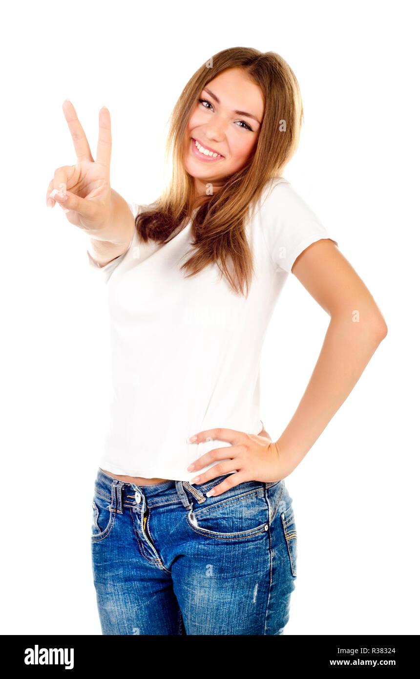 young girl showing victory sign isolated on a white background Stock Photo