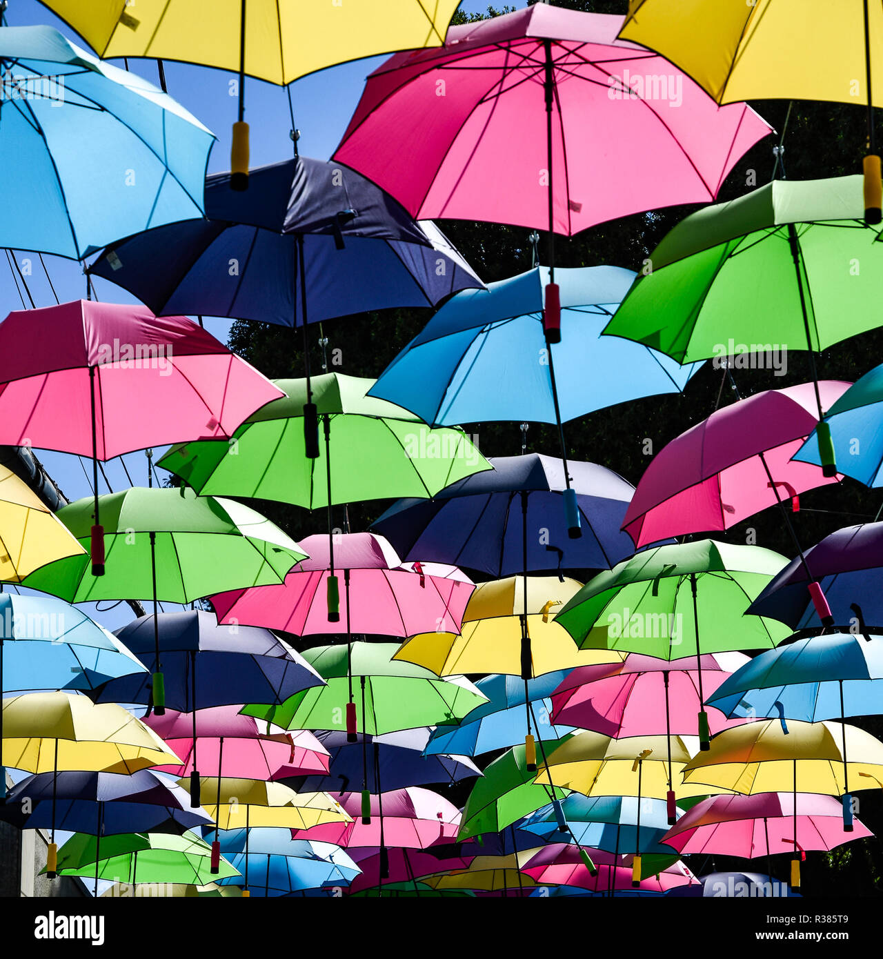 Floating Colorful umbrella cover - Stock Image