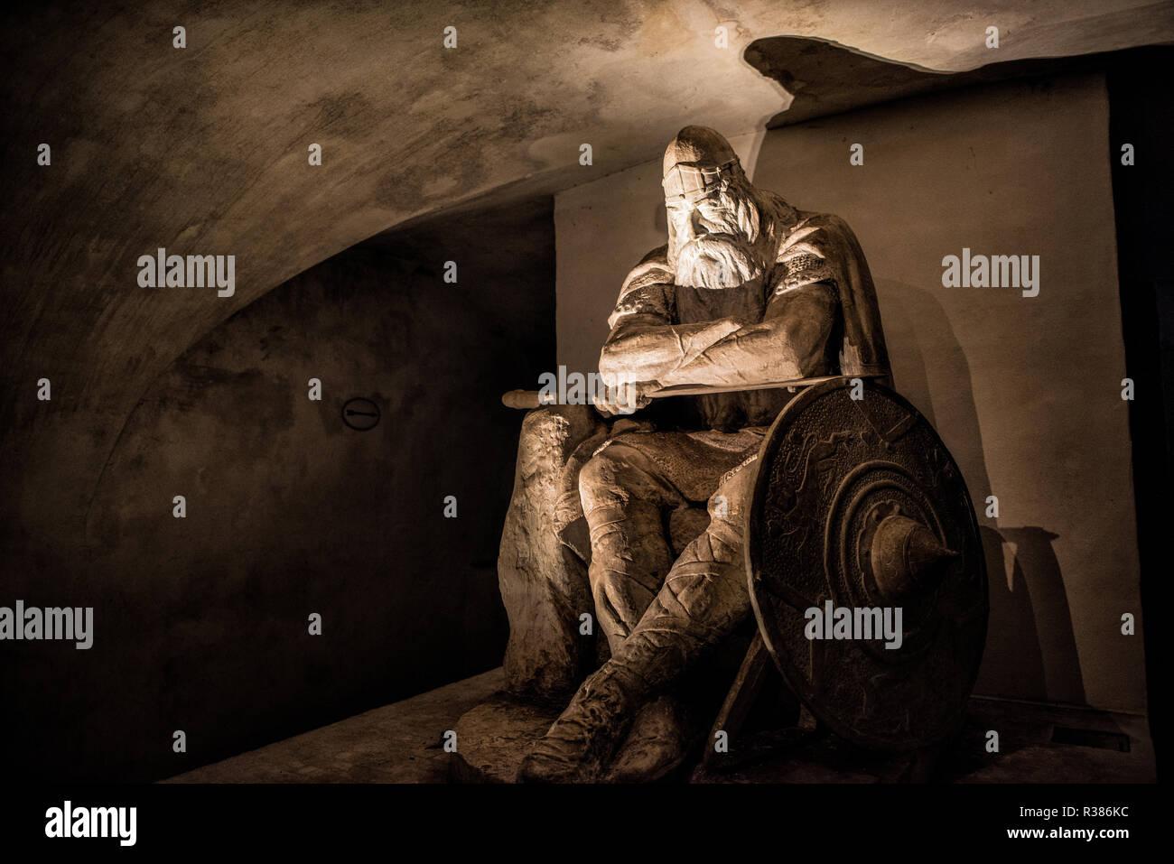 A statue of Holger the Dane by Hans Peder Pedersen-Dan in the casemates under Kronborg Castle. According to legend, Holger remains sleeping until he's - Stock Image