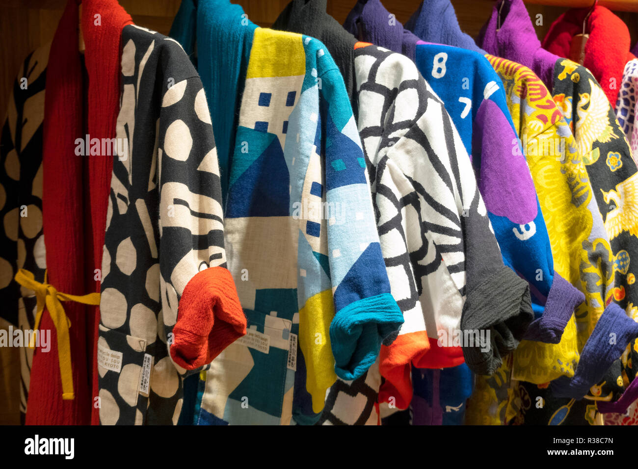 Modern Japanese fashion brand Sou Sou using colorful prints in Kyoto flagship store. Their design is inspired by traditional Japanese clothing. - Stock Image