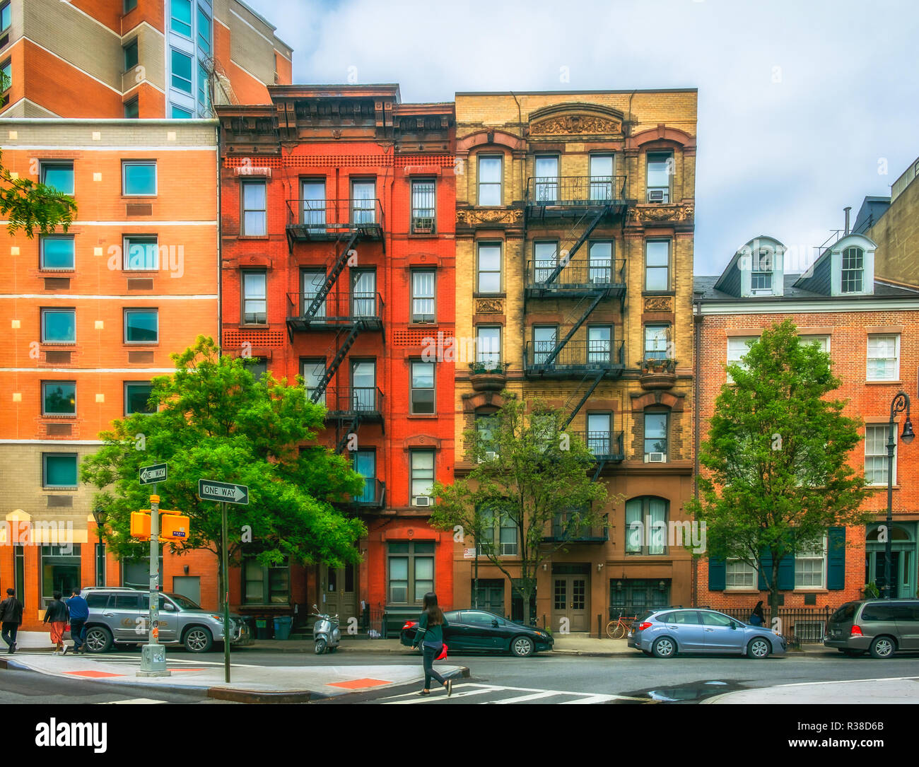 New York City, USA, May 2018, example of the gentrification in the East Village with two old buildings in between modern constructions in Stuyvesant - Stock Image