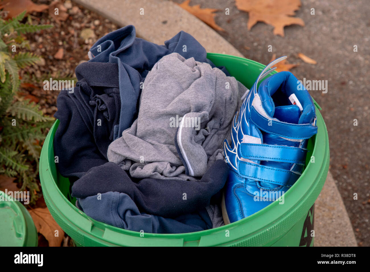 old fashion collection in a green bucket at the road - Stock Image