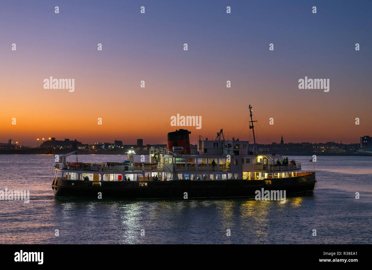 Ferry on the River Mersey at night looking towards Birkenhead, Liverpool, England, UK - Stock Image