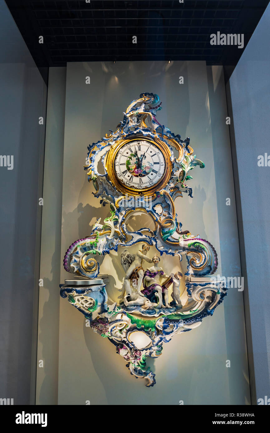 Clock in artistic porcelain setting, National Museum, Munich, Upper Bavaria, Bavaria, Germany - Stock Image