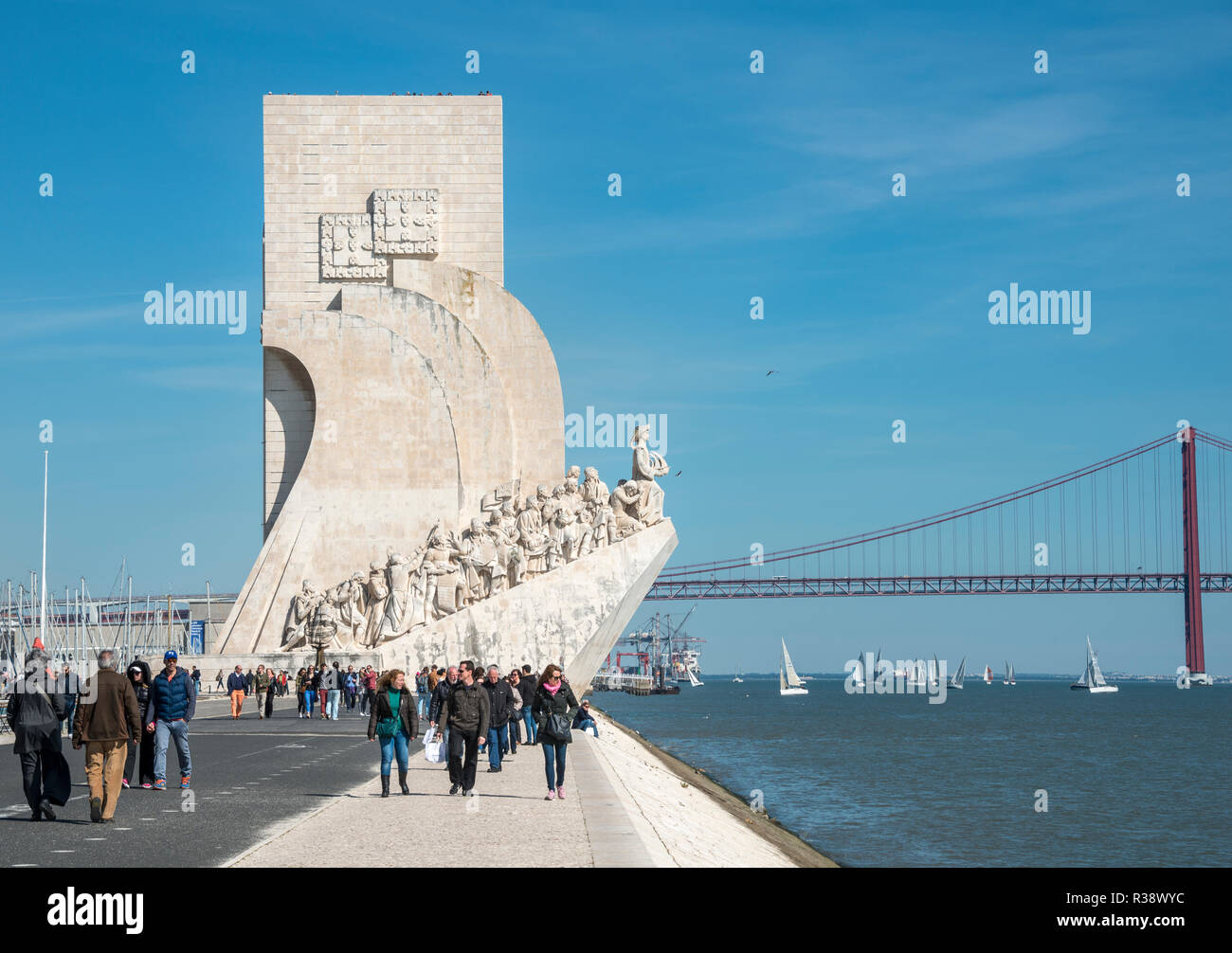 Monument of Discoveries, Padrão dos Descobrimentos with Ponte 25 de Abril, Promenade at the Rio Tajo, Belem, Lisbon, Portugal - Stock Image