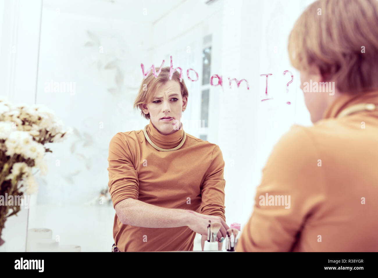 Frustrated abandoned transgender feeling bad about his identity - Stock Image