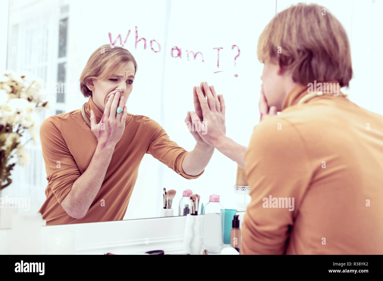 Stressful gender-queer young boy getting confused with his mentality - Stock Image