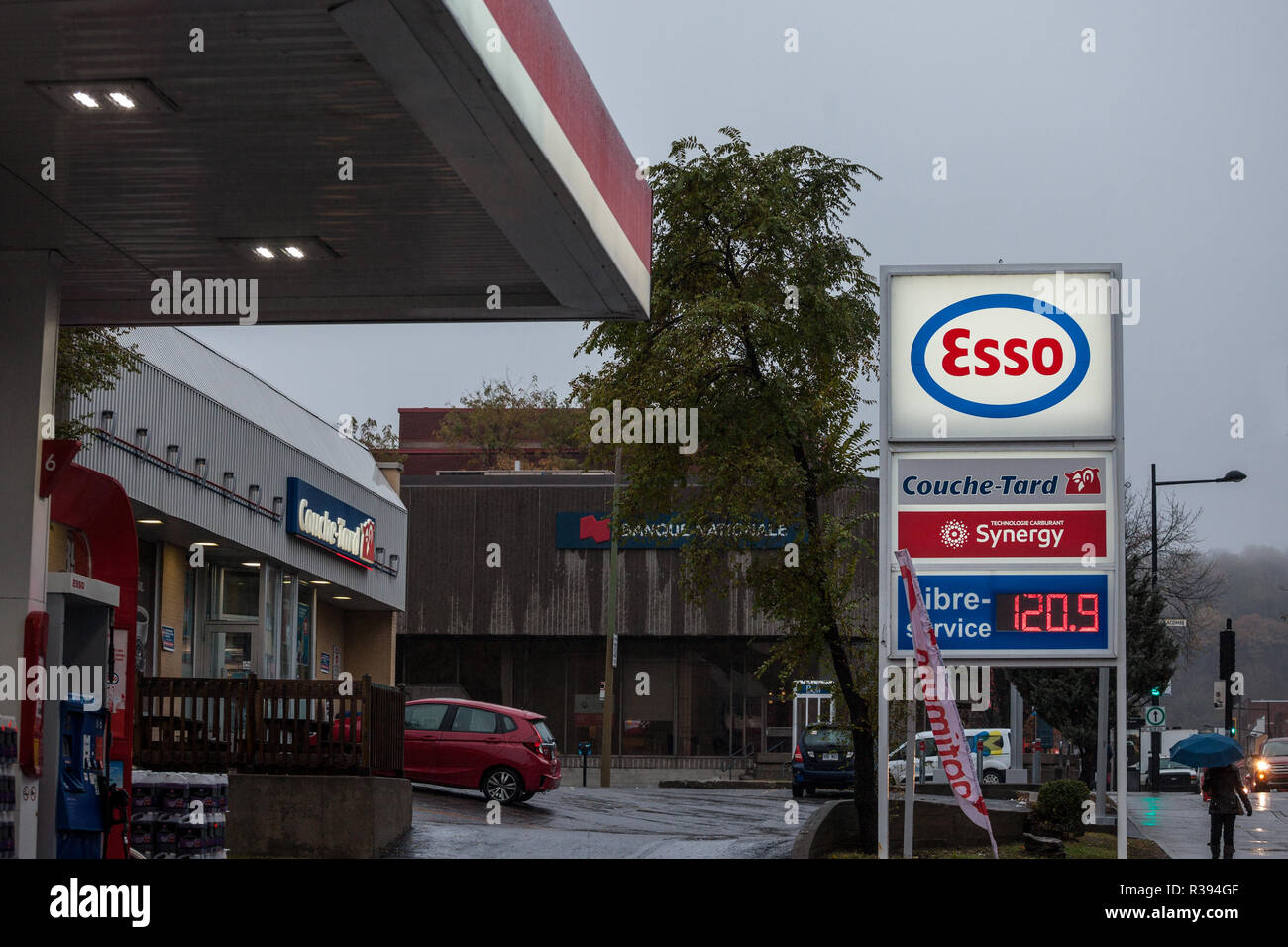 MONTREAL, CANADA - NOVEMBER 3, 2018: Esso logo in front of one of their gas stations in Canada. Esso is one of the petroleum production and sales bran - Stock Image
