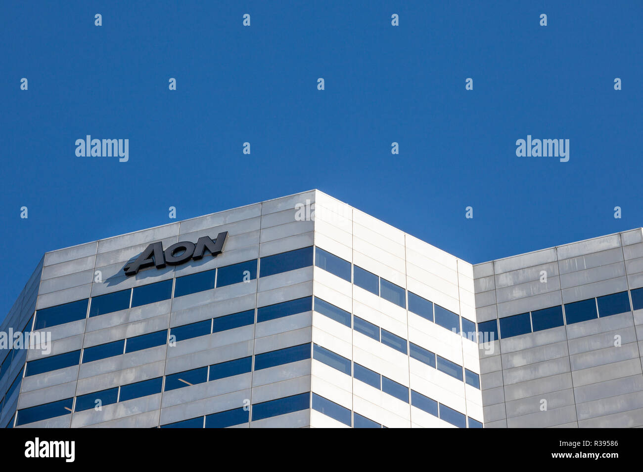 MONTREAL, CANADA - NOVEMBER 4, 2018: AON logo in front of their heaquarters for Quebec. AON is a risk, health and retirement consulting, as well as an - Stock Image