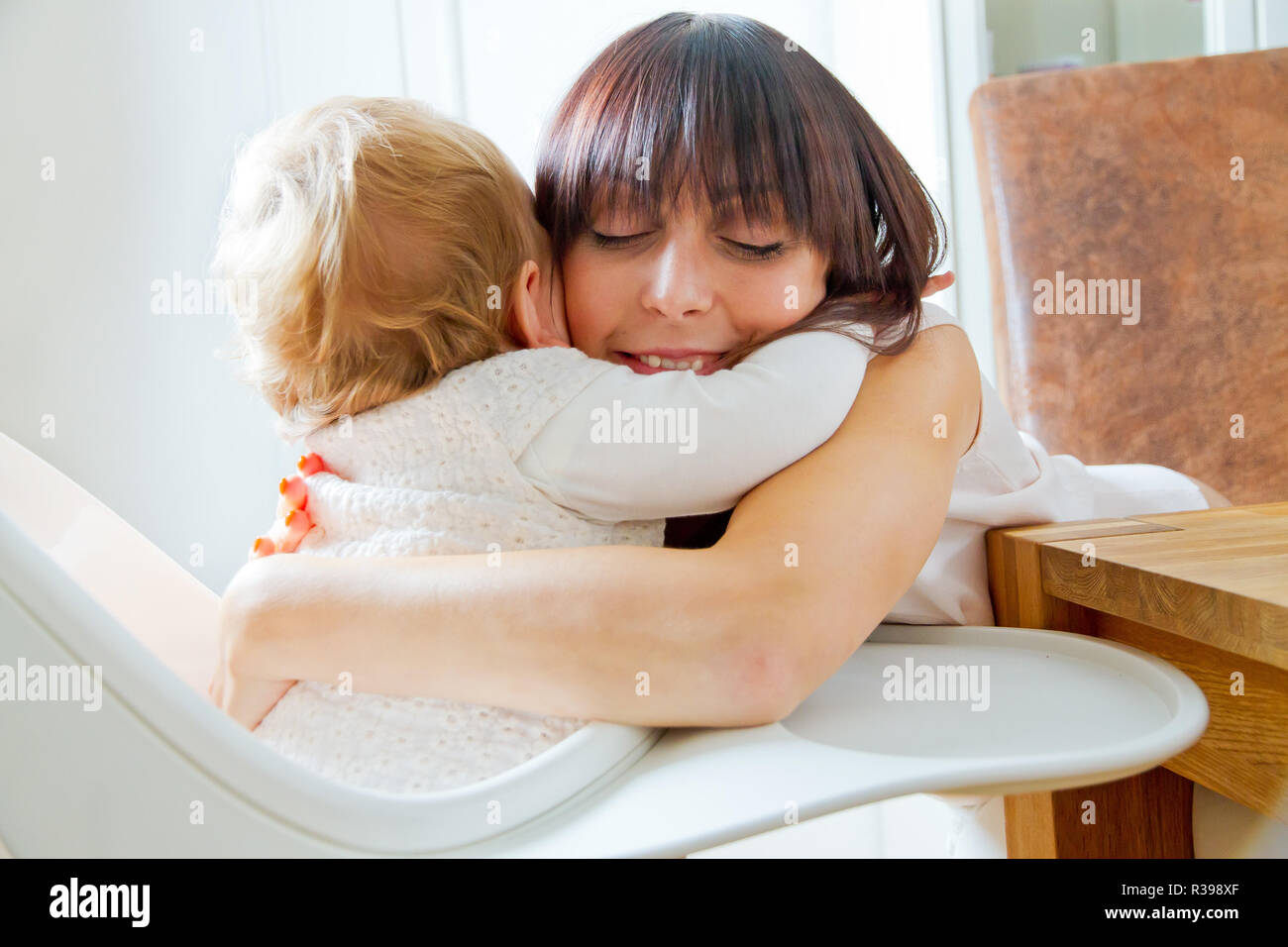 baby and mother hug Stock Photo