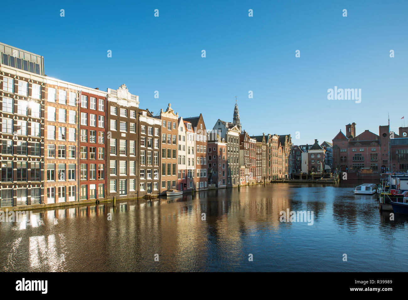 Amsterdam city view of Netherlands traditional houses with Amstel river in Amsterdam, Netherlands - Stock Image