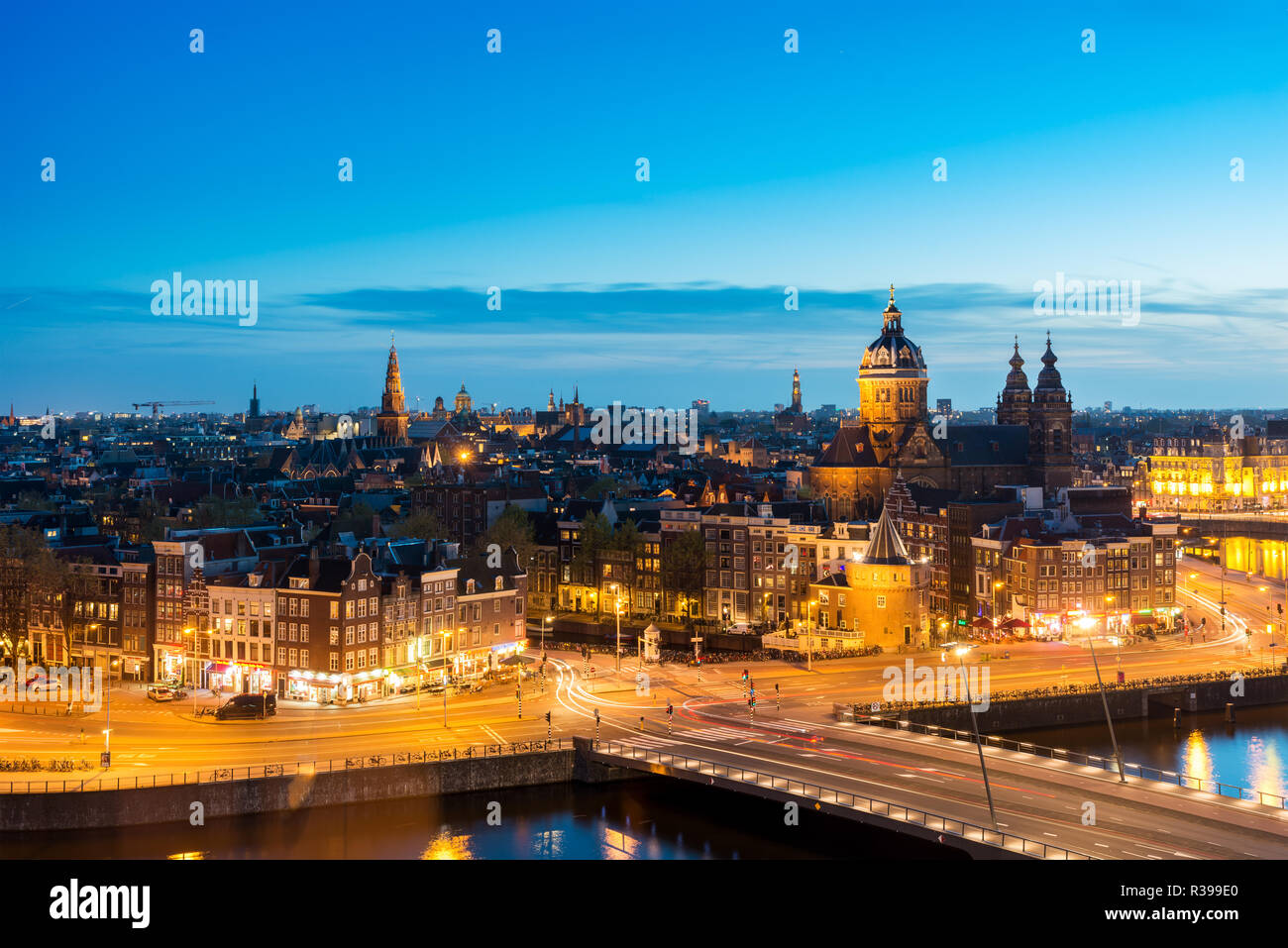 Amsterdam skyline in historical area at night, Netherlands. Ariel view of Amsterdam, Netherlands. - Stock Image