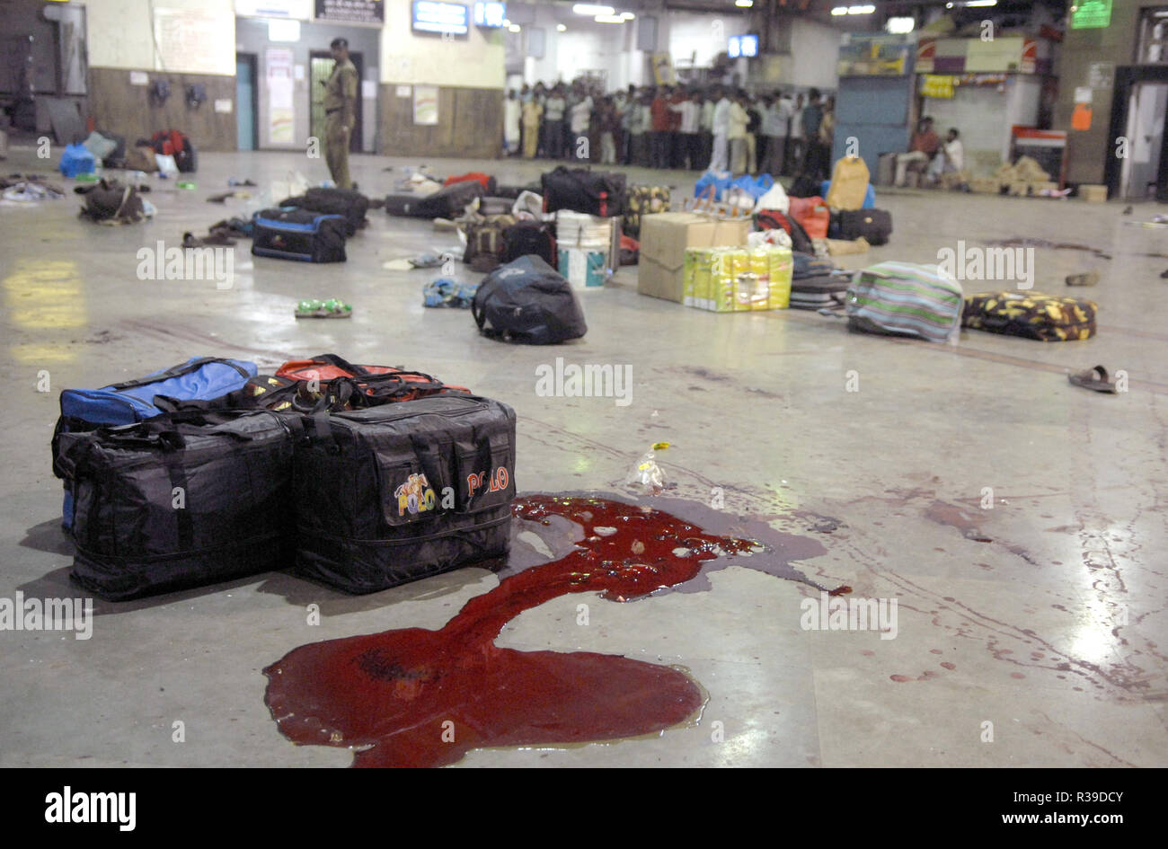 Left luggage and blood stains of terror attack by Deccan Mujahideen terrorists in Mumbai CST station, India on 27/11/2008. Terrorists killed 100 people and wounded more than 200 in a series of coordinated attacks across India?s financial hub Mumbai as Heavily armed gunmen in groups of two to four opened fire with automatic weapons and lobbed grenades in 10 places in south Mumbai, including the five-star Taj and Trident hotels, the city?s main railway terminus, a hospital, a cafe, a pub and a cinema hall. Photo: Dinodia    (c) dpa - Report      usage worldwide - Stock Image