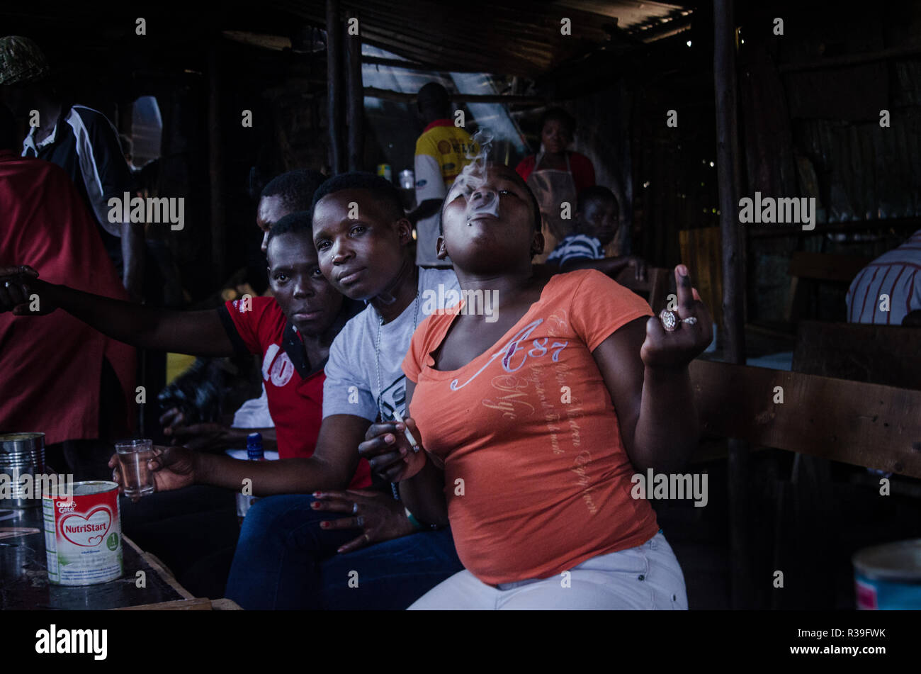 Kenya. 16th Nov, 2018. Women of kibera are seen having fun with alcoholic drinks at a local bar.For a long period of time, most women from Kibera slums have been under the influence of Alcohol. Not considering the side effects, women here consume it for different reasons including taking over stress and forgetting about their family problems back home. This is due to lack of enough job opportunities and support from their husbands.The high level of alcohol consumption has led to higher rate of deaths, blindness, and risk of many dangerous diseases such as cancer, hypertension, stroke and - Stock Image