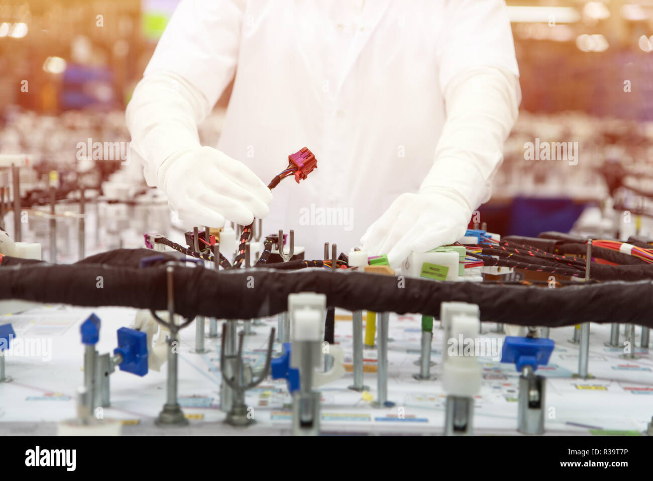 Checking the wiring systems on control desk, checkpoint, automotive industry, high-quality products, highlight effect - Stock Image