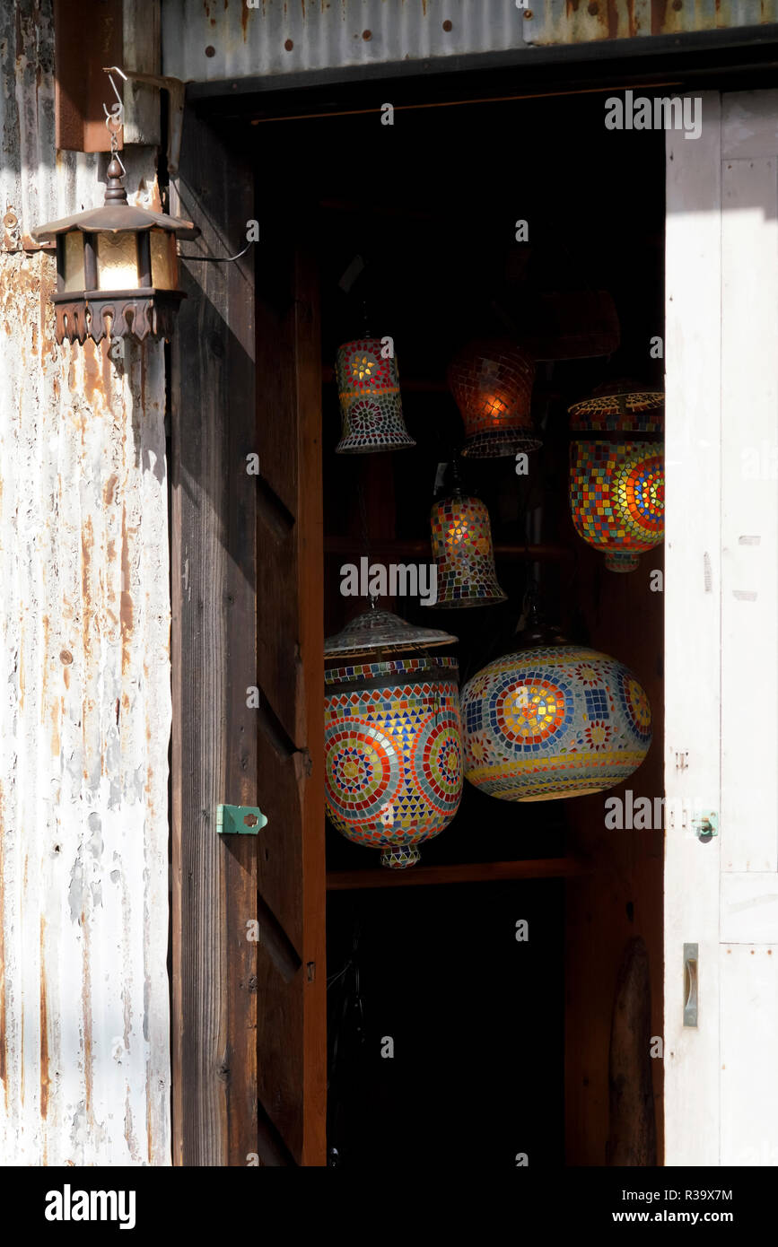 old colorful lamps hanging house entrance, street lighting - Stock Image