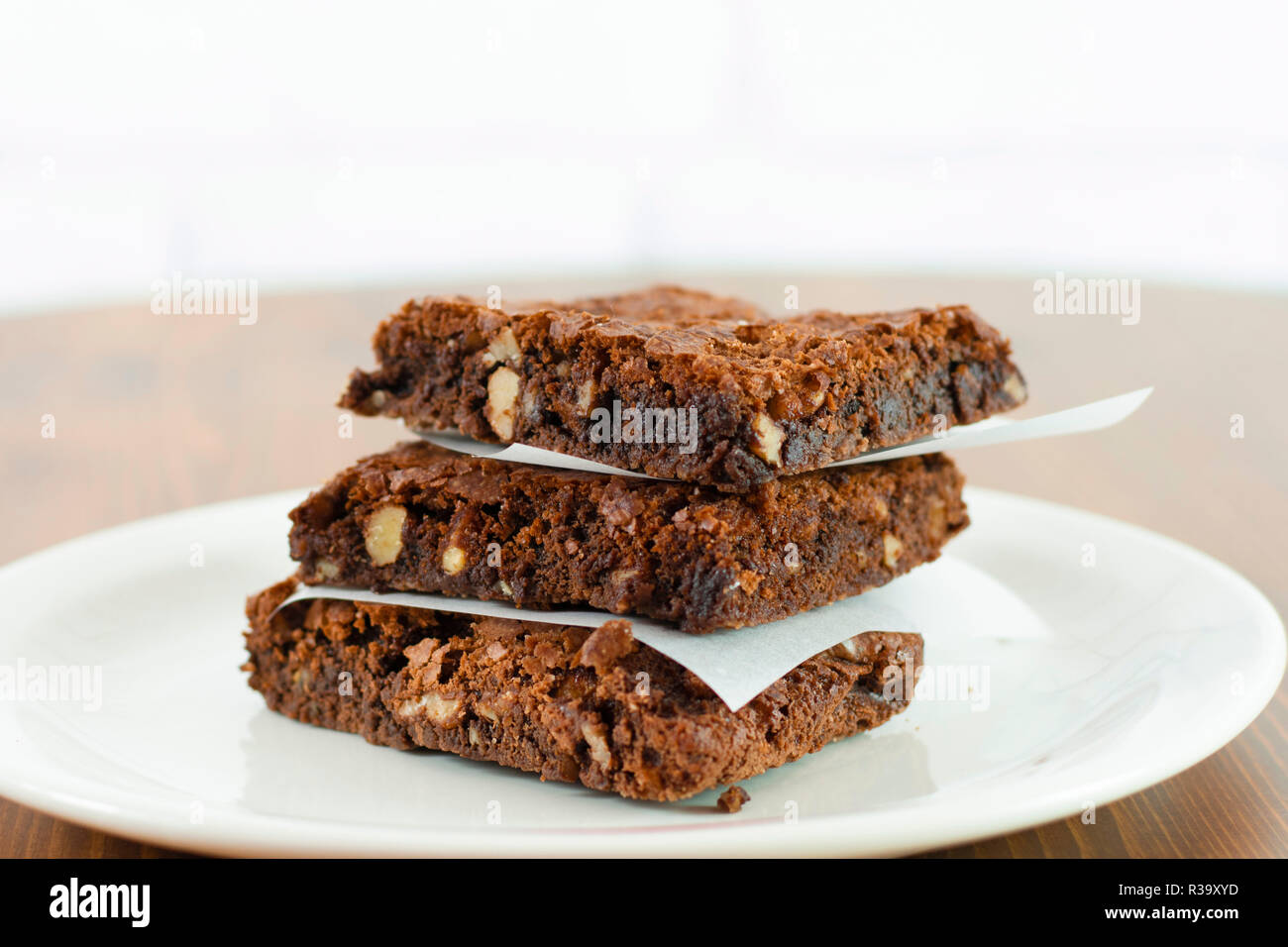 Sliced delicious brownie with hot chocolate melting sauce on it. - Stock Image