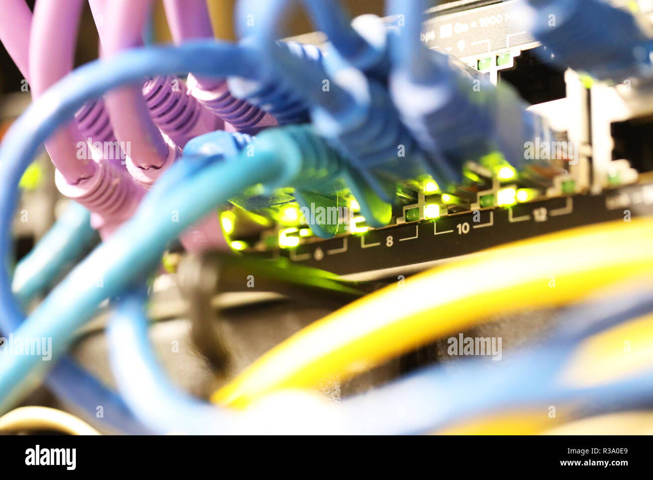 telephone and internet data communication cables, cabling and wires in a port. Infrastructure for communicating and systems in a modern office or work - Stock Image