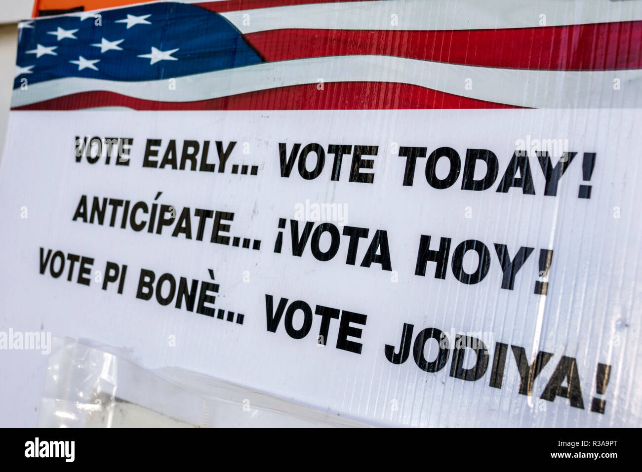 Miami Beach Florida City Hall sign vote here Spanish English Creole languages - Stock Image