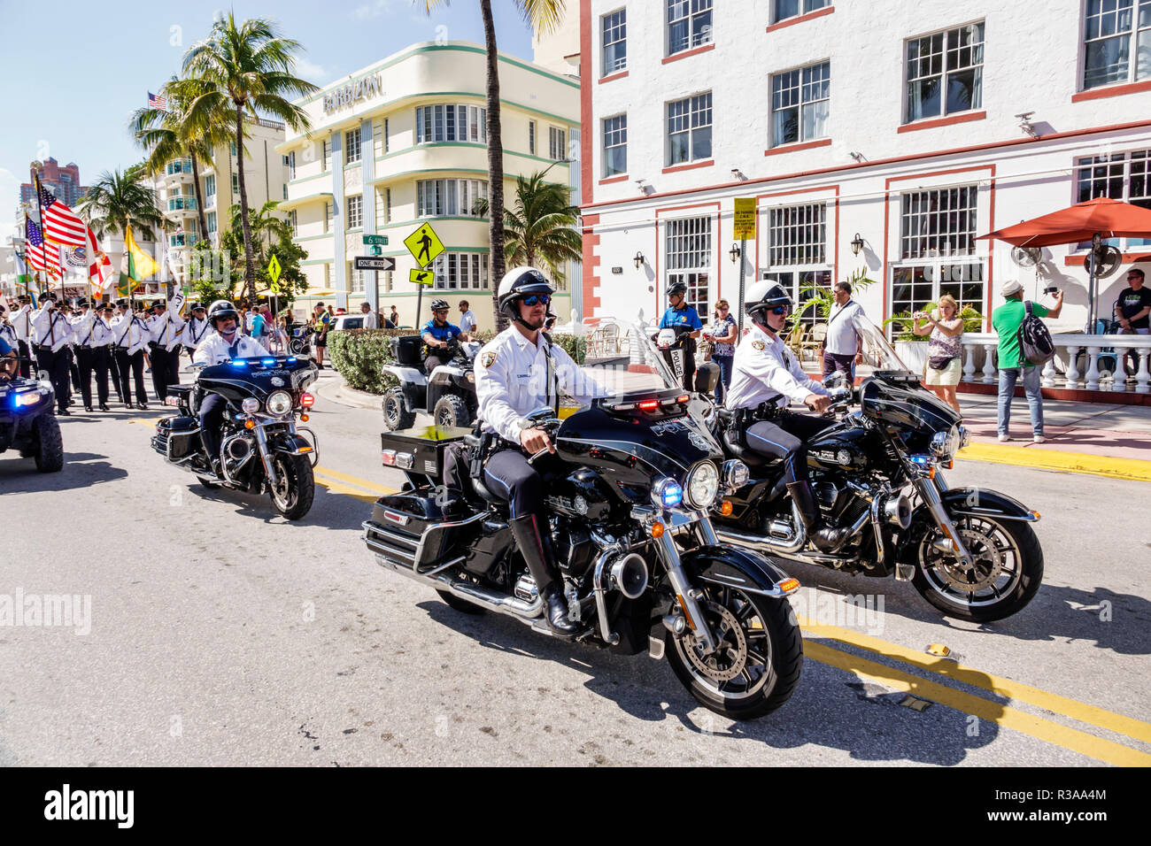 Miami Beach Florida Ocean Drive Veterans Day Parade activities Police Department motorcycle brigade motorcycles formation patrol - Stock Image