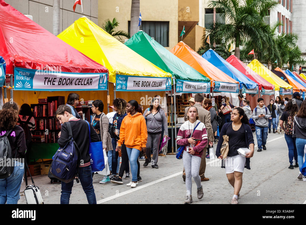 Miami Miami Florida-Dade College Book Fair annual event booths stalls vendors booksellers books sale Hispanic teen girl shopping - Stock Image