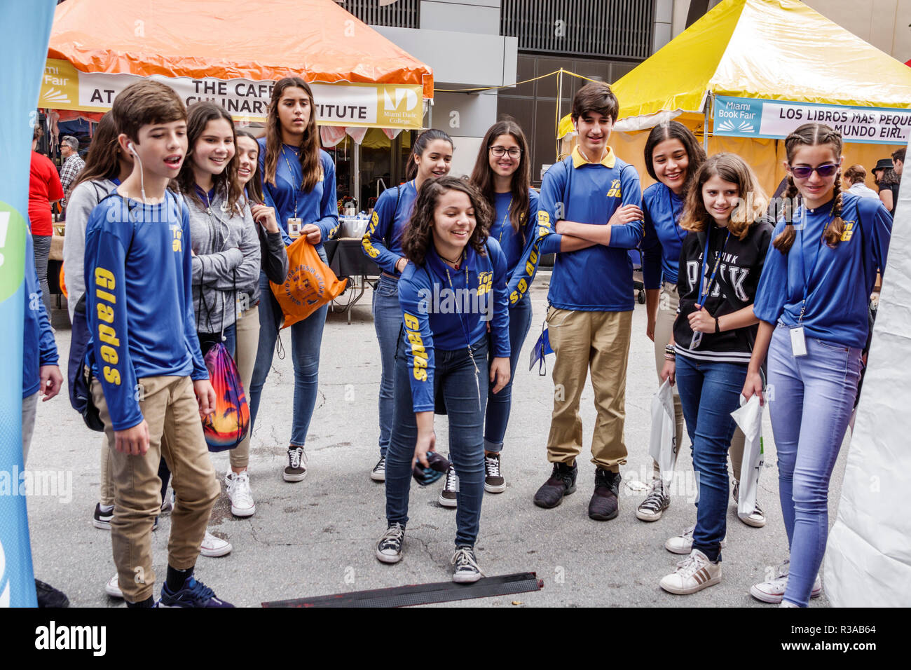 Miami Miami Florida-Dade College Book Fair annual event booths stalls vendors booksellers books sale shopping bean bag toss teen boy girl student watc Stock Photo