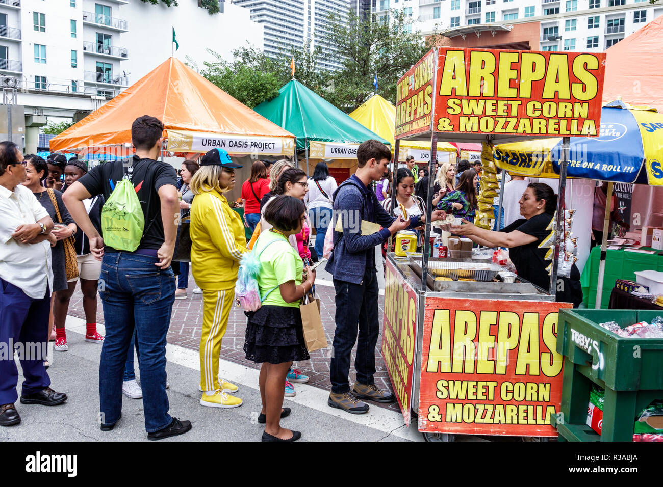 Miami Miami Florida-Dade College Book Fair annual event booths stalls vendors booksellers books sale shopping food vendor arepas sweet corn customers - Stock Image