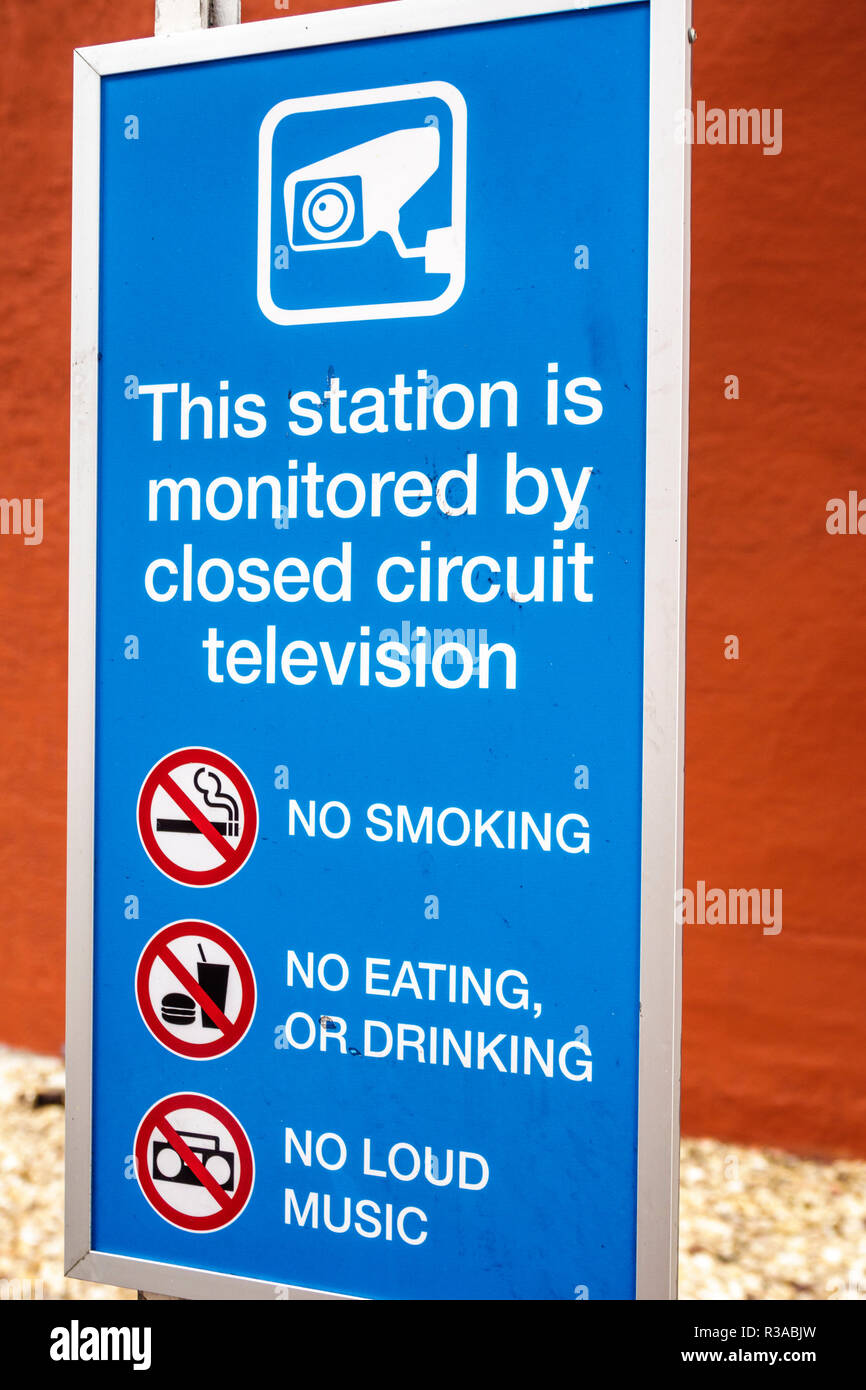 Miami Florida sign Metromover station monitored by closed circuit television no smoking drinking eating loud music rules - Stock Image