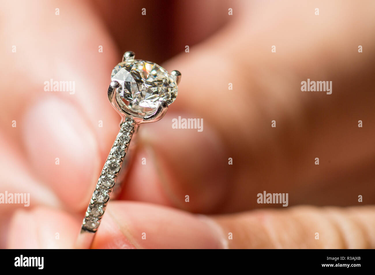 Man's Hands Holding Ring For Proposal - Stock Image