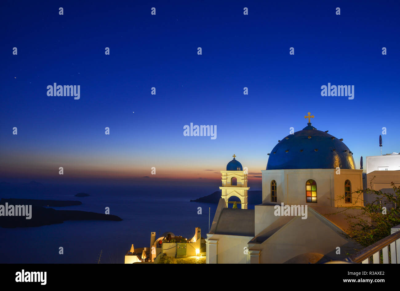 Catholic Church with seascape at twilight in Santorini, Greece. - Stock Image