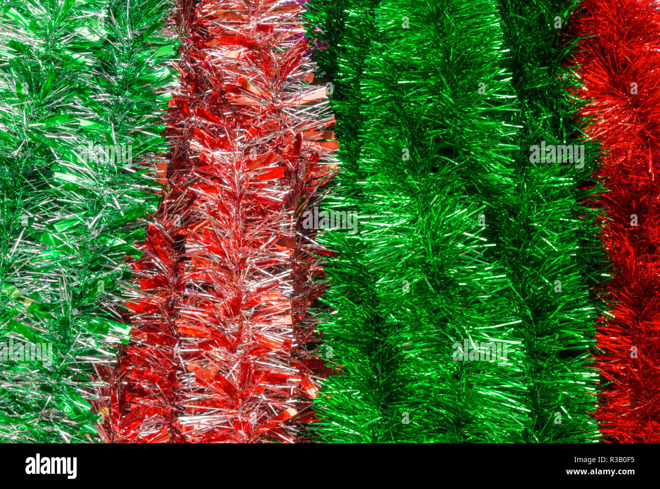 Red and green Christmas tinsel detail - Stock Image