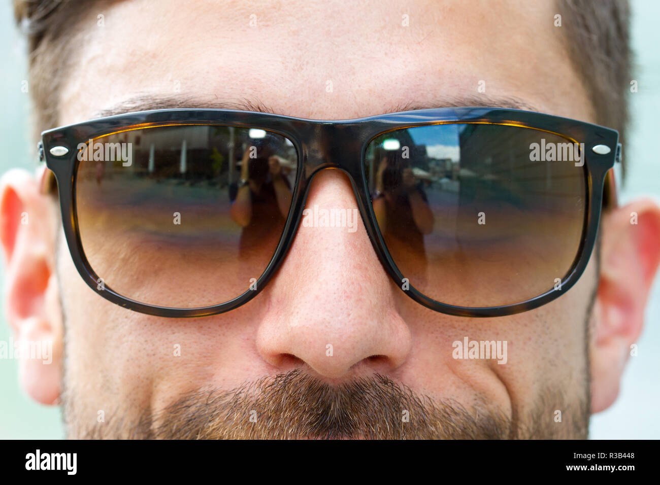 young,modern man in the sun Stock Photo