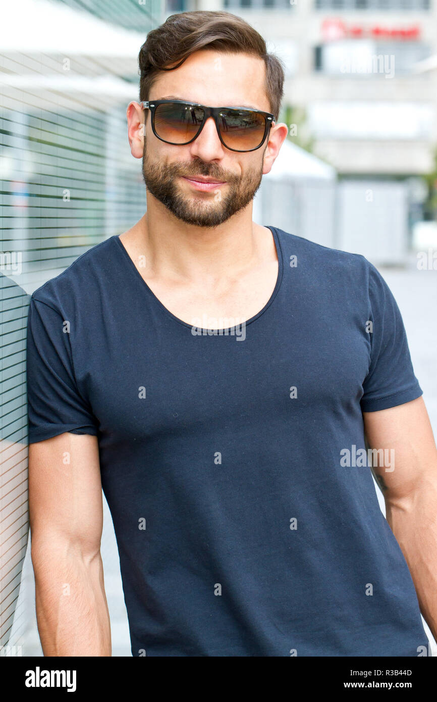 young,athletic man with sunglasses Stock Photo