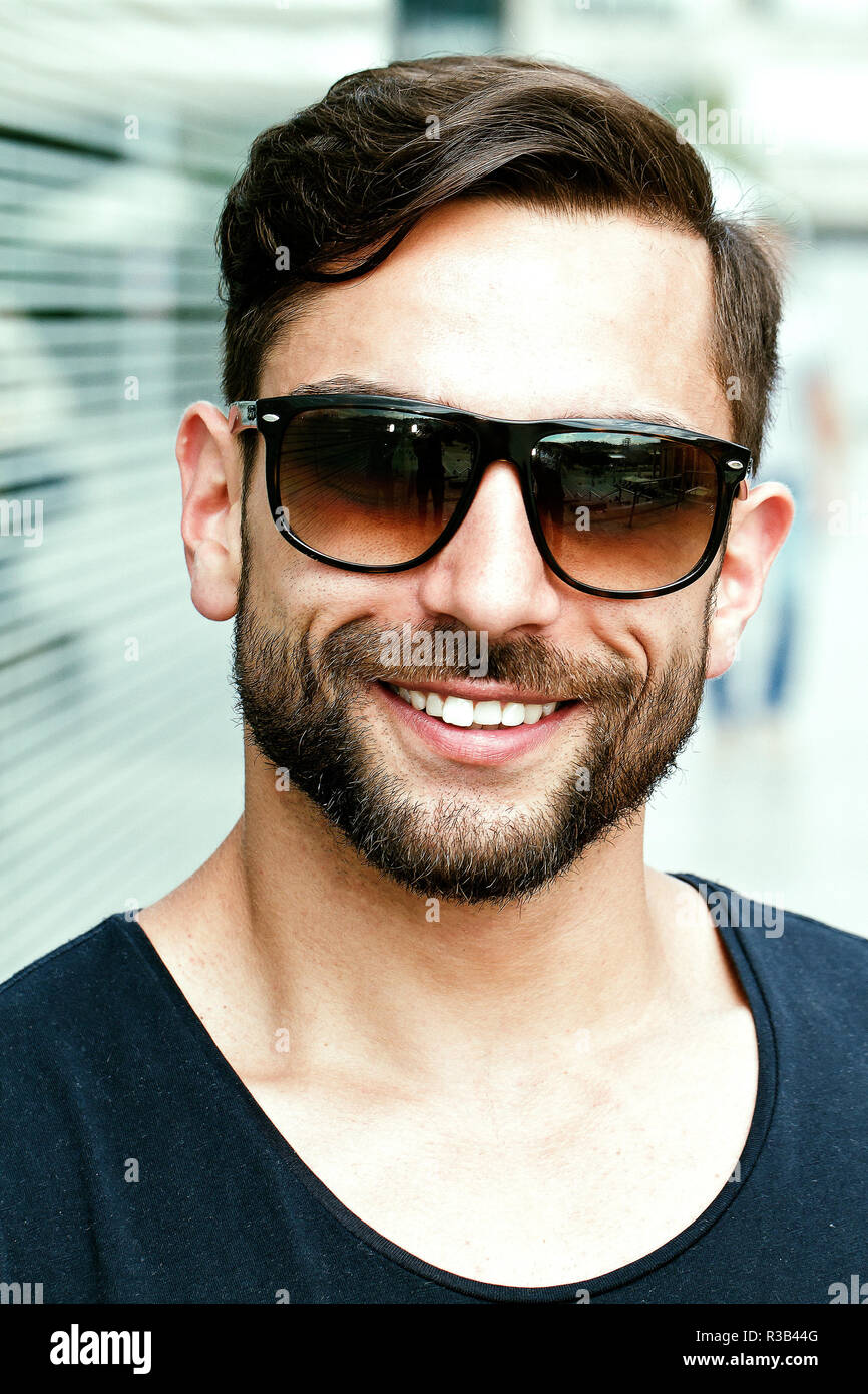 young attractive man wearing sunglasses Stock Photo