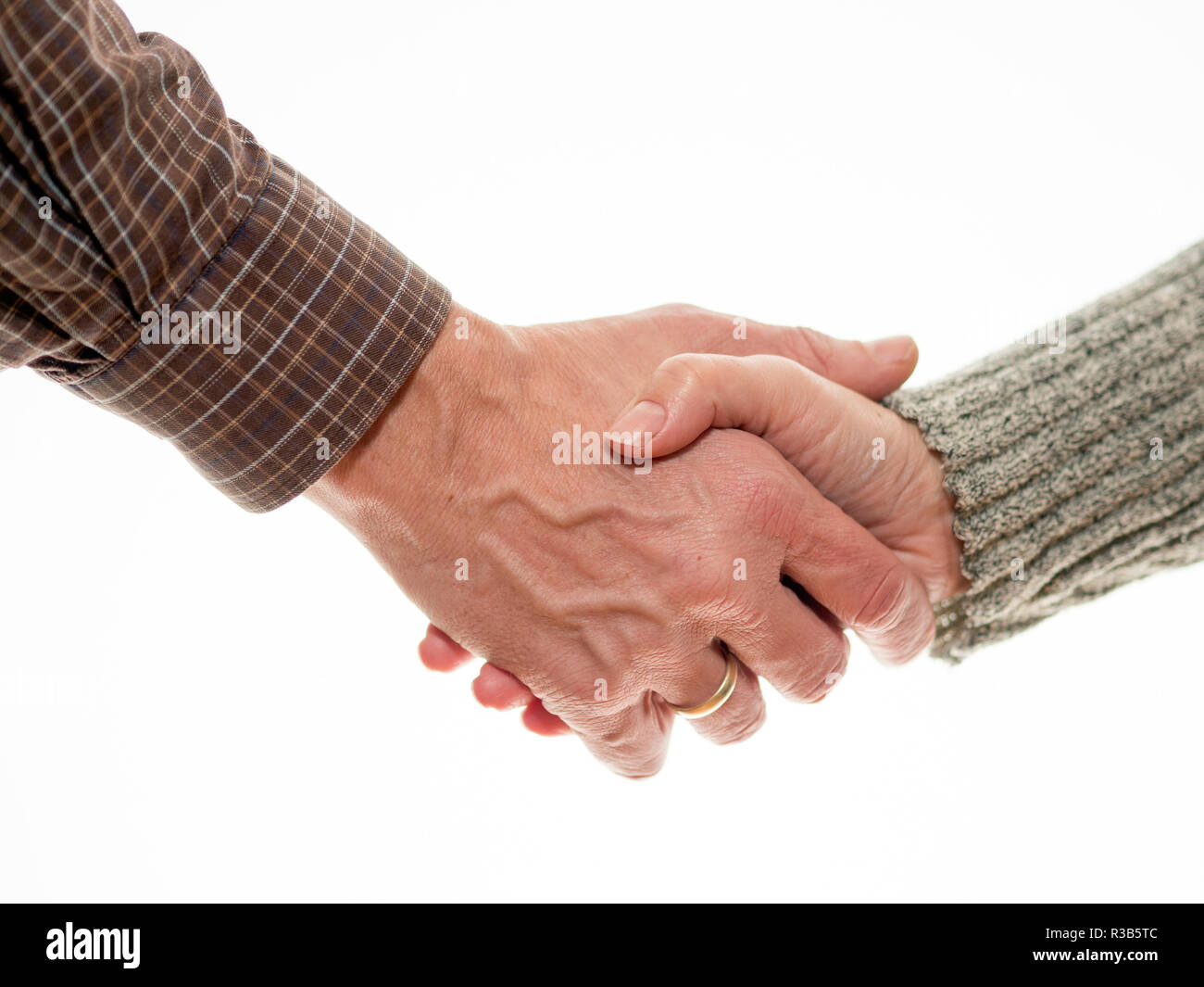 man and woman are shaking hands - Stock Image