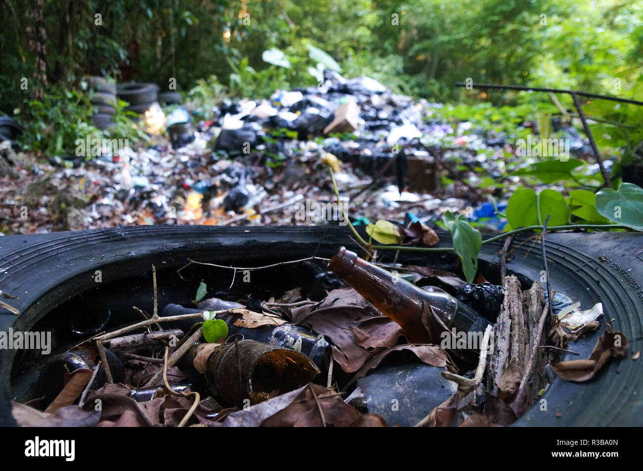 Garbage pile in trash dump or landfill in jungle of Guatemala. Pollution concept. - Stock Image
