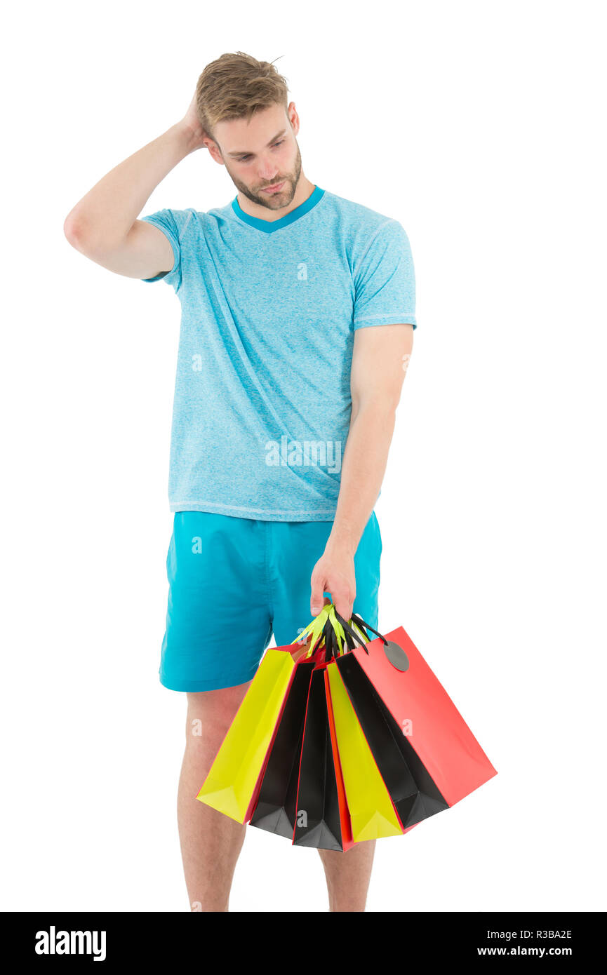 Shopping confusing him. Man handsome unshaved macho hold bunch shopping bags. Buy gifts concept. Guy shopping before holidays. Shopping discount sale season. Man carry paper bags with items. - Stock Image