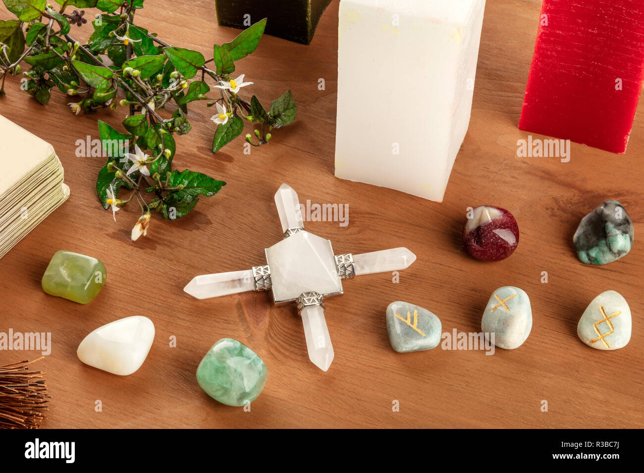 Magic. A photo of a Wiccan altar with candles, crystal stones, and Norse runes, with Tarot cards. Fortune-telling concept Stock Photo