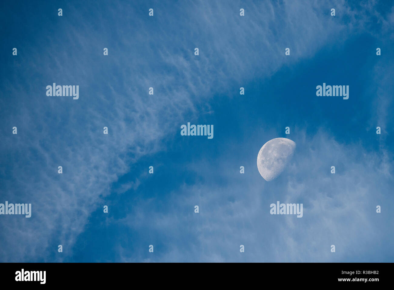 Moon with clouds and blue sky. Stock Photo