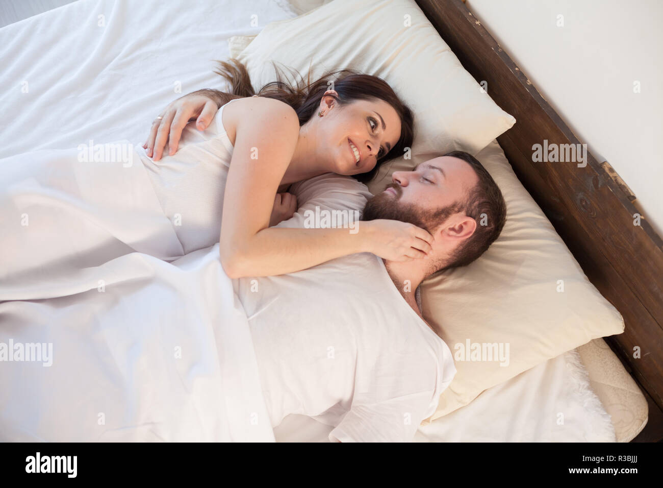 man and woman, husband and wife woke up in the morning after sleep - Stock Image