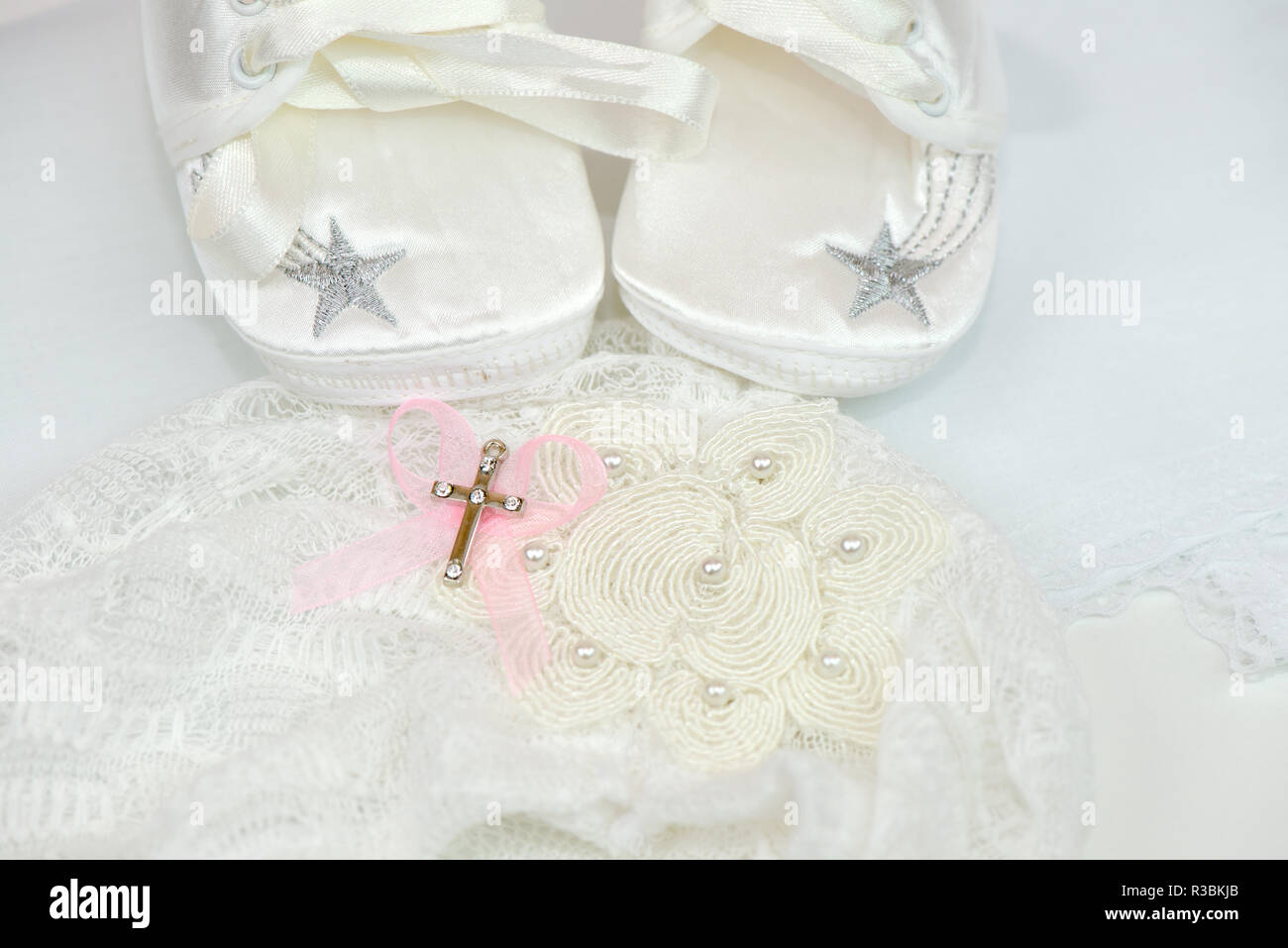 Accessories for christening baby shoes and cross - Stock Image