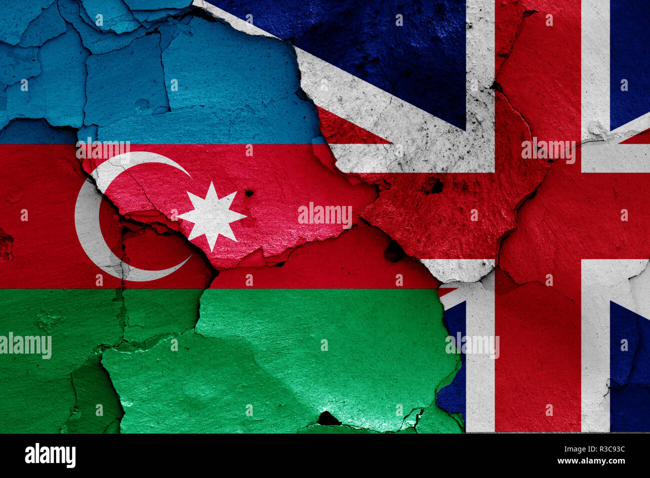 flags of Azerbaijan and UK painted on cracked wall - Stock Image