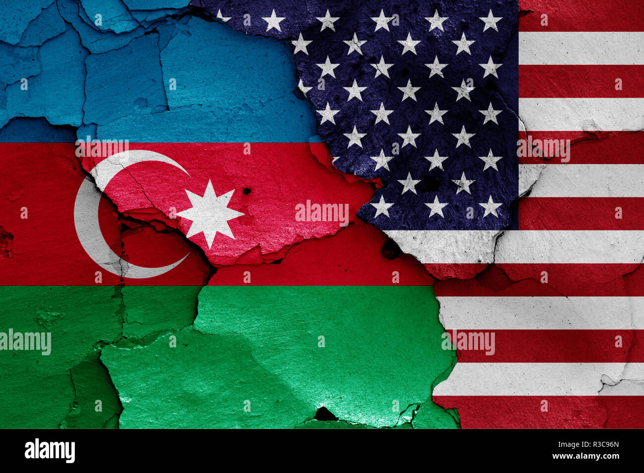 flags of Azerbaijan and USA painted on cracked wall - Stock Image